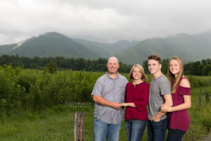 True smoky mountains as the backdrop for family portraits in Cades Cove